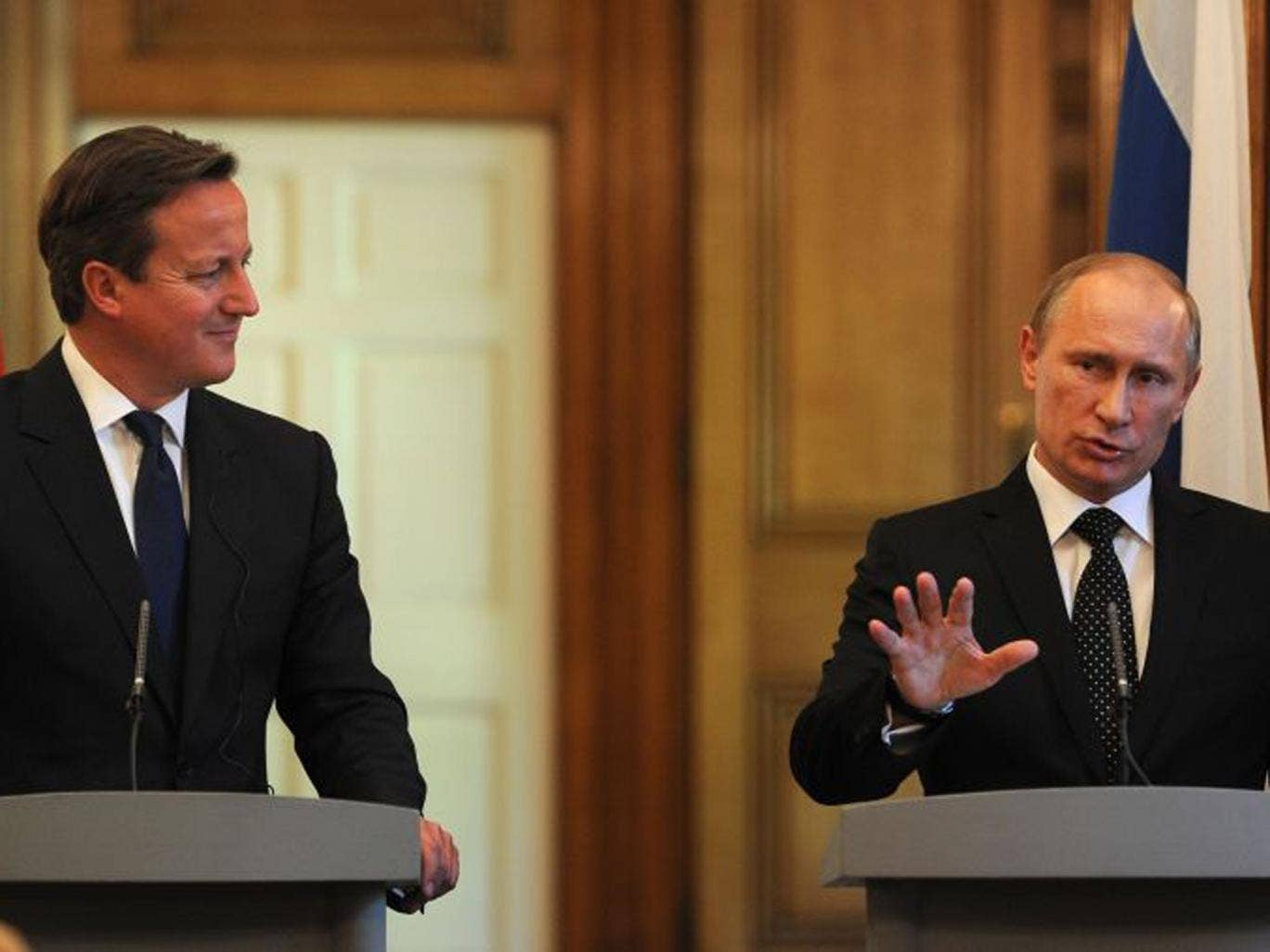 "The Russian President, Vladimir Putin, rounded on Britain on Sunday, accusing David Cameron of betraying humanitarian values by supporting Syrian rebels with ""blood on their hands"""