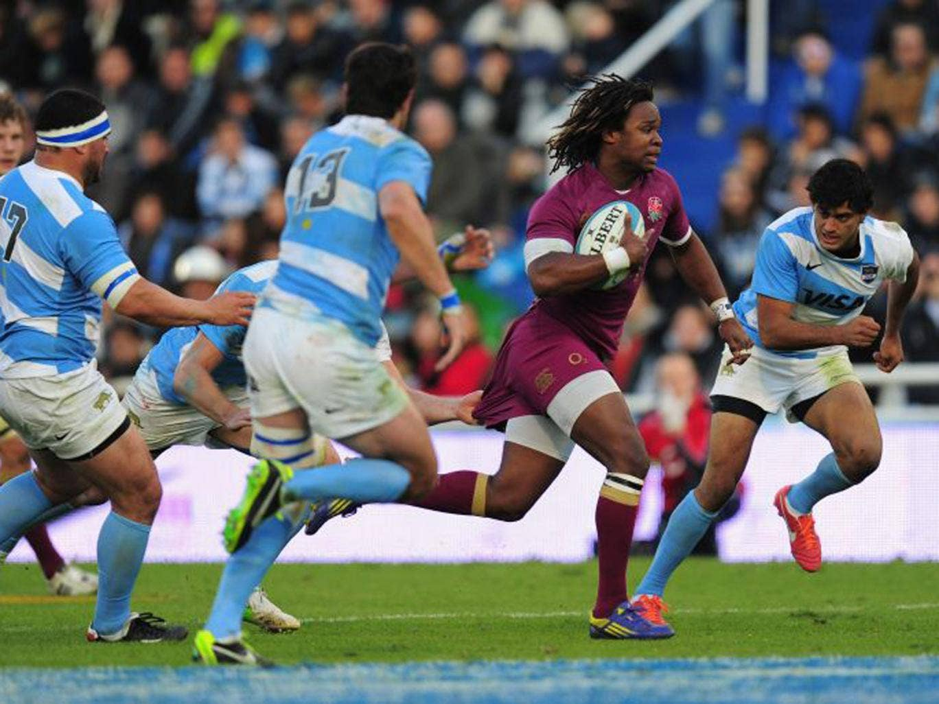 England's Marland Yarde makes a break against Argentina on Saturday