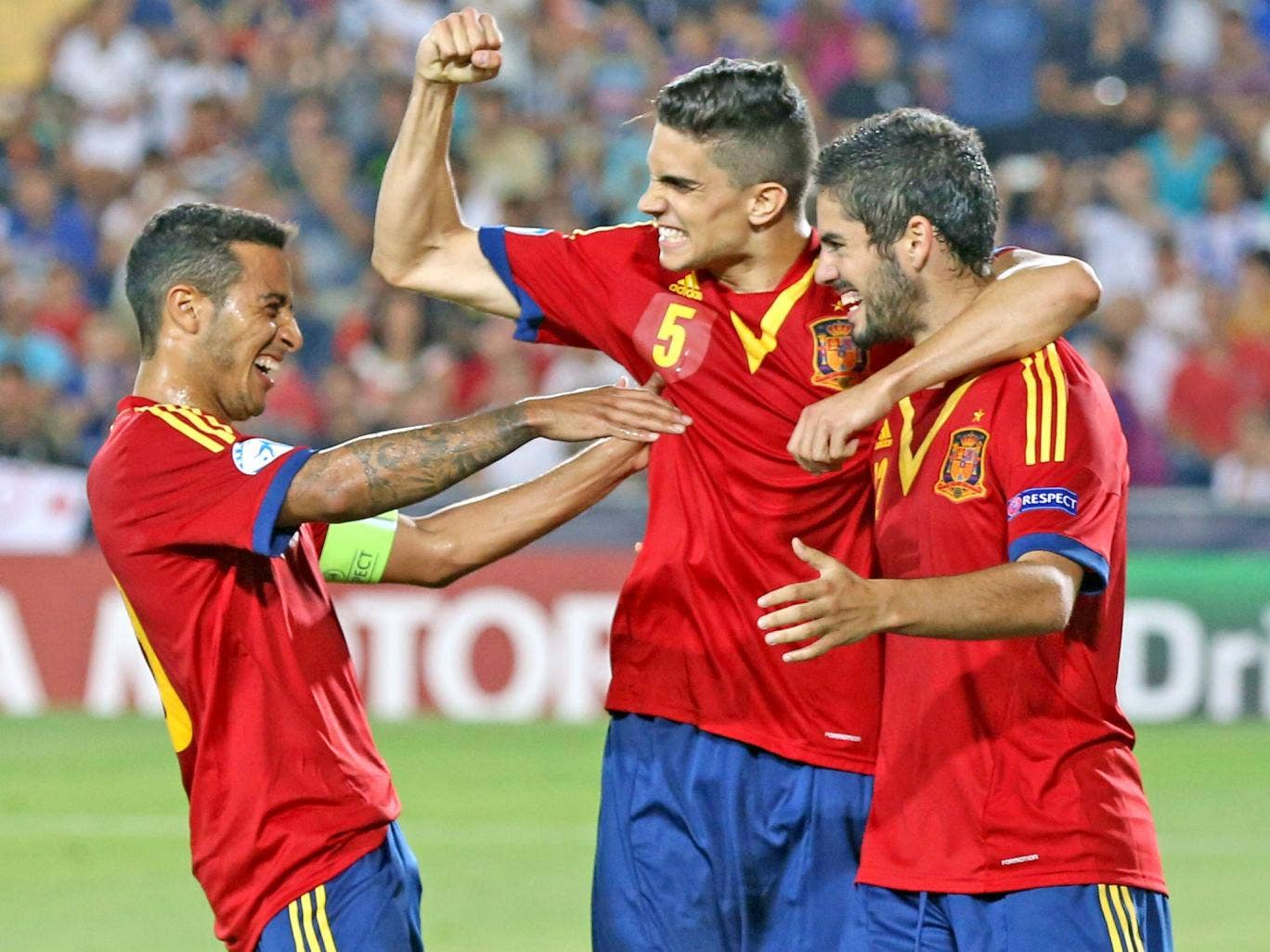Isco (right) celebrates Spain's fourth goal with teammates Marc Bartra (centre) and Thiago, who scored the first three