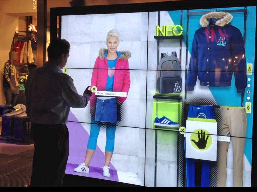 An interactive window in an Adidas shop