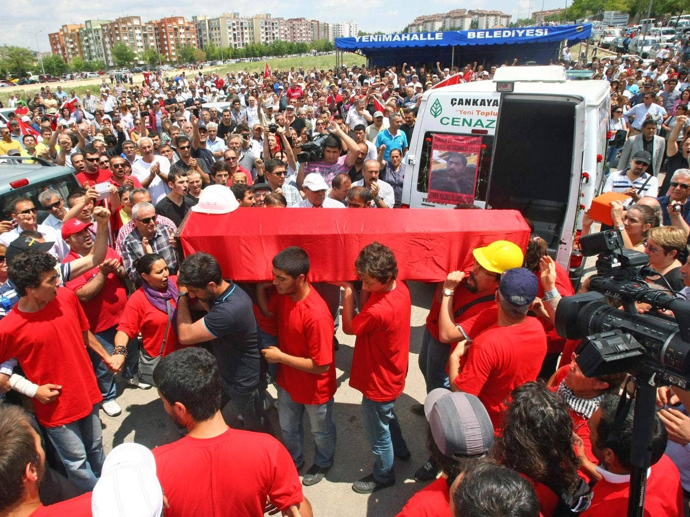 The coffin of Ethem Sarisuluk is carried at his funeral on Sunday