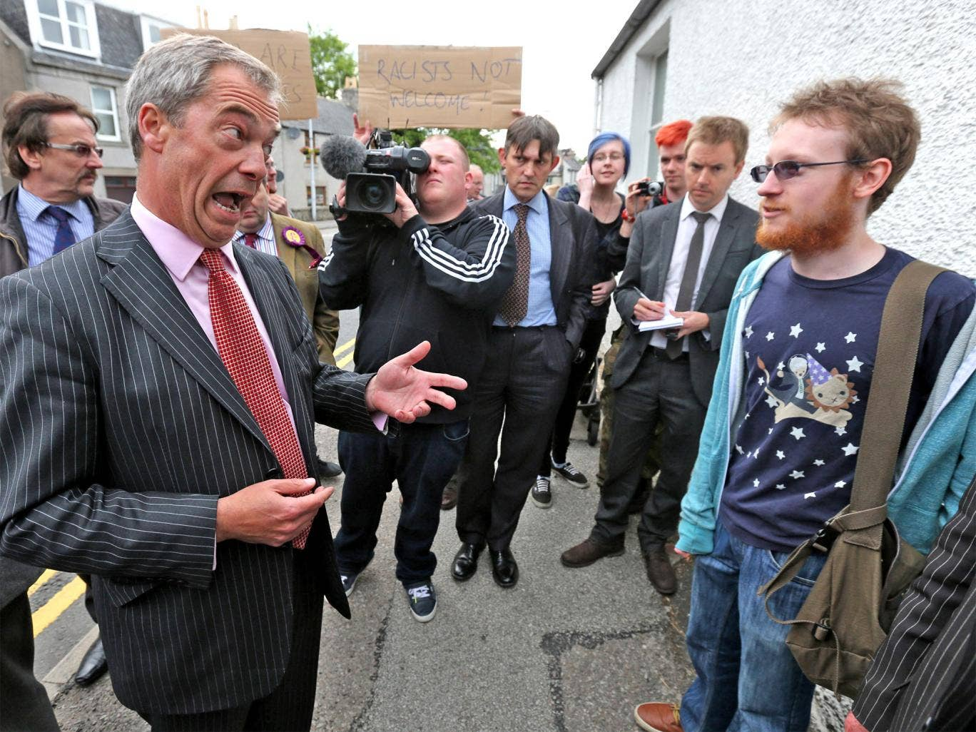UKIP Leader Nigel Farage speaks to the cola-throwing protester moments before the incident