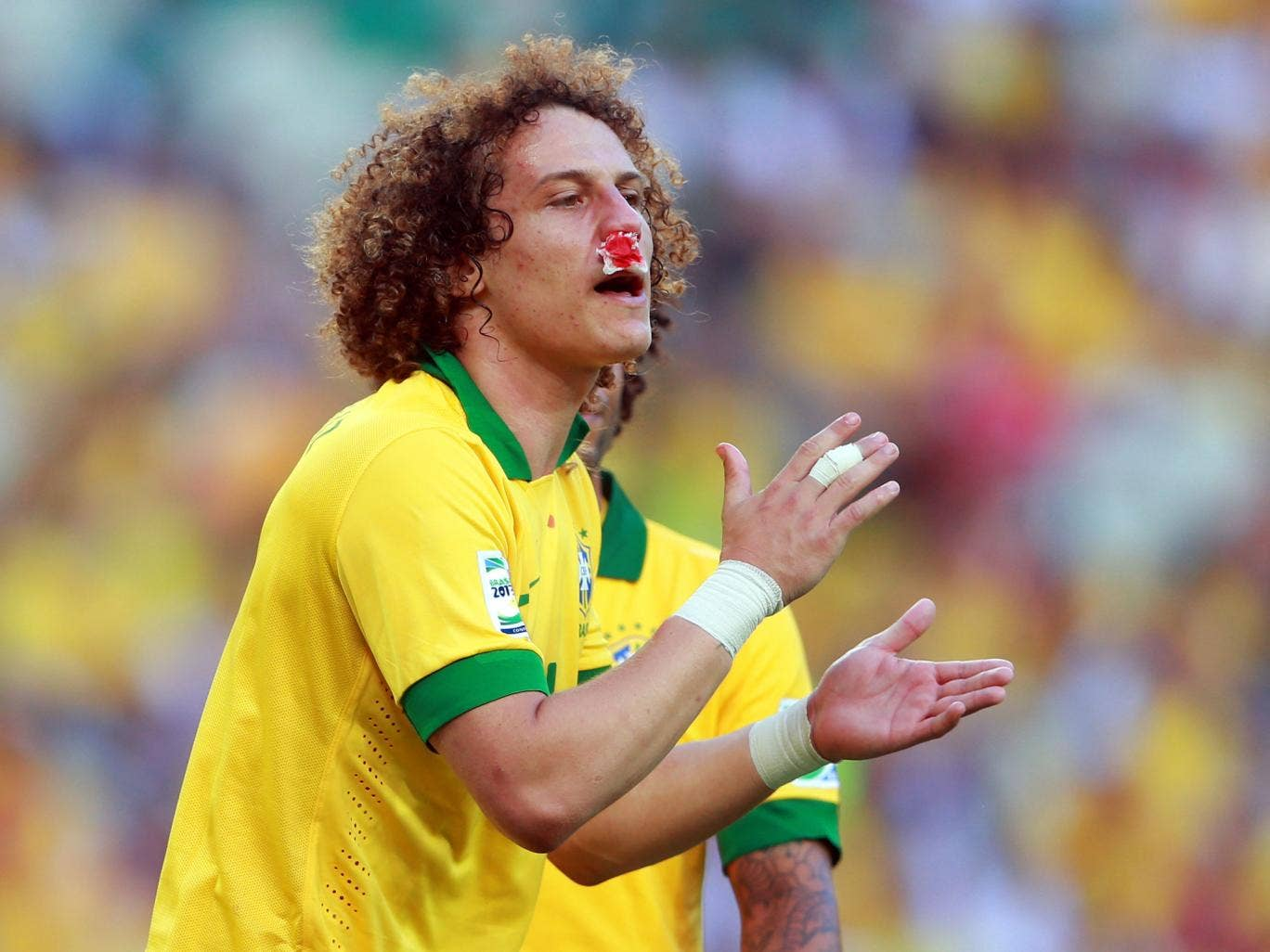 David Luiz in action for Brazil after he suffered a broken nose