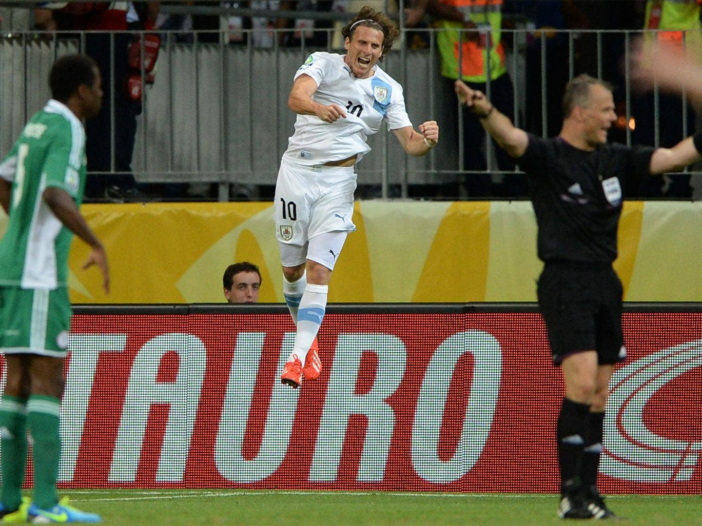 Diego Forlan celebrates his goal against Nigeria