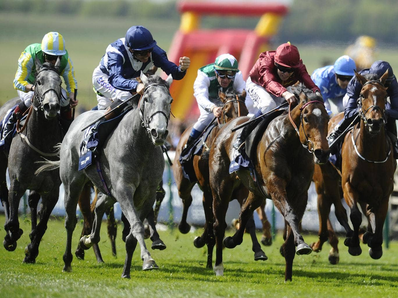 Sky Lantern (L) powers past the field to win the Coronation Stakes at Royal Ascot