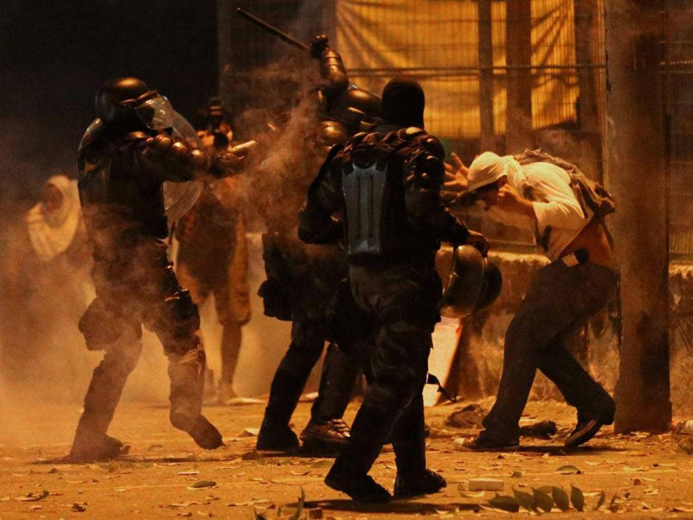 Gas attack: Riot police go into heavy-handed action against one of the 300,000 demonstrators on the streets of Rio