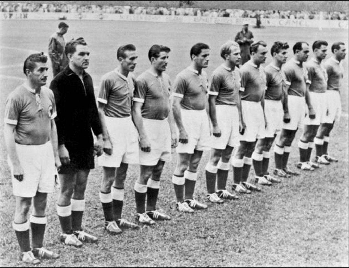 Walter, fifth from left, with the West Germany team in 1954, and below, with a picture of his old self at a ceremony in 2004 to mark the 50th anniversary of his side's famous victory