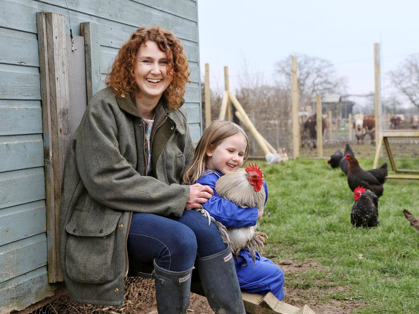 After the storm: Kirsty Grocott at home in Shropshire with her youngest child, Minnie, now aged four