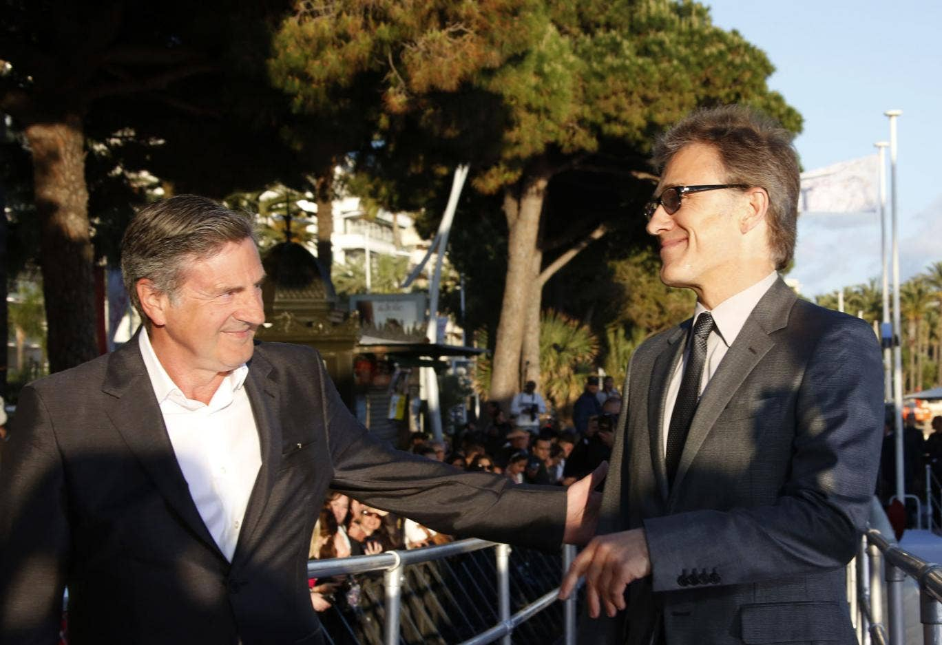 French actor and member of the Feature Film Jury Daniel Auteuil (L) and Austrian actor and member of the Feature Film Jury Christoph Waltz arrive to take part in the TV show 'Le Grand Journal'