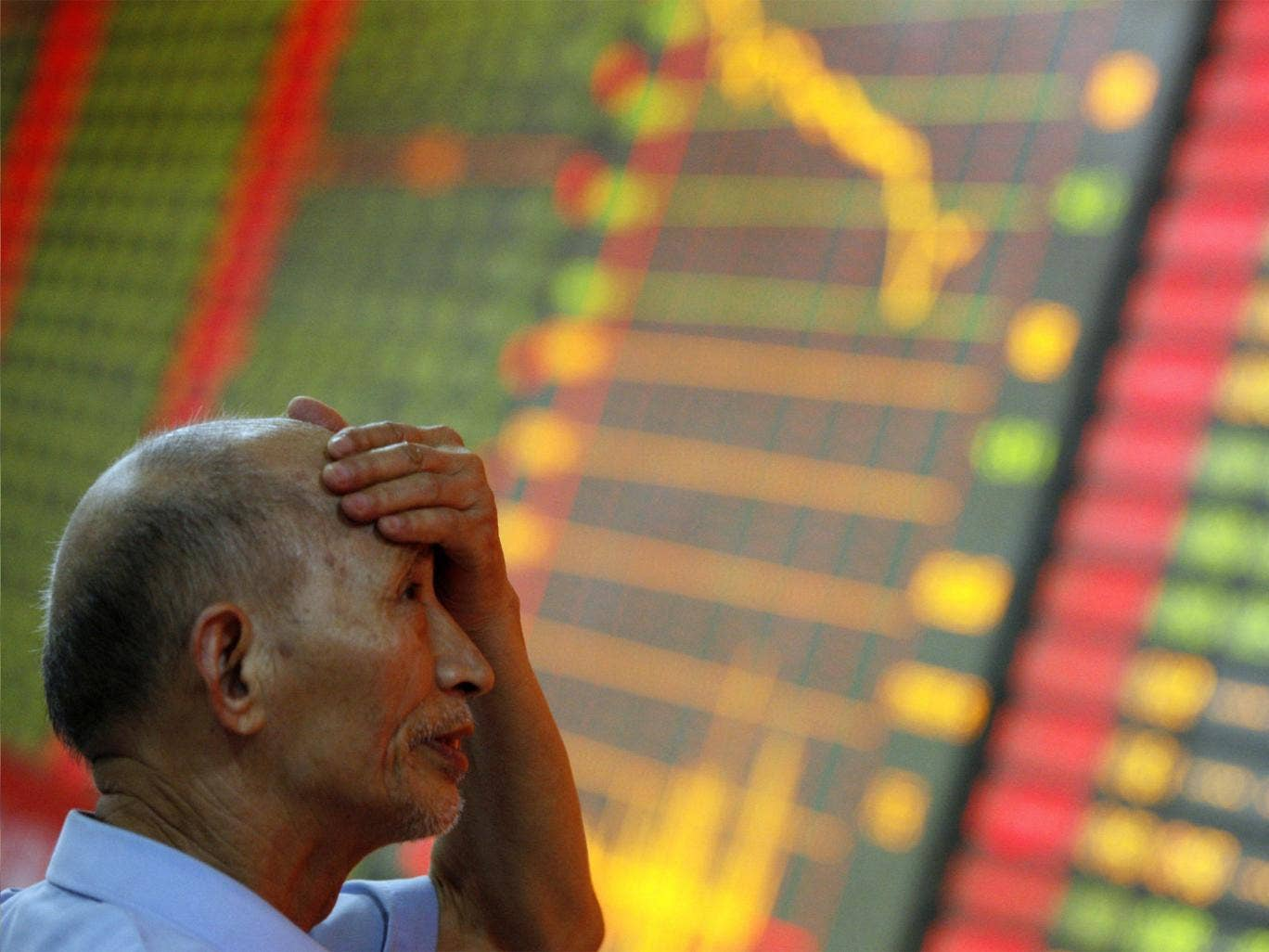 An investor gestures at the volatility of Chinese stock markets
