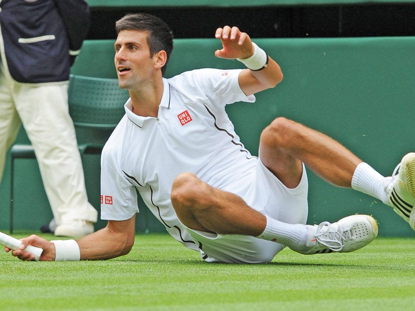 Novak Djokovic takes a tumble during his match against Florian Mayer