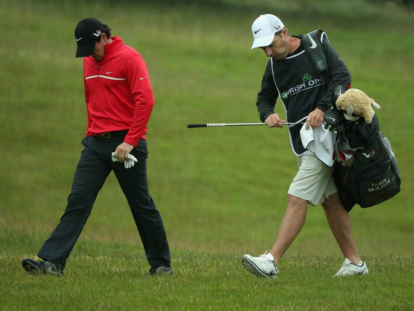 A dejected Rory Mcilroy and caddie JP Fitzgerald