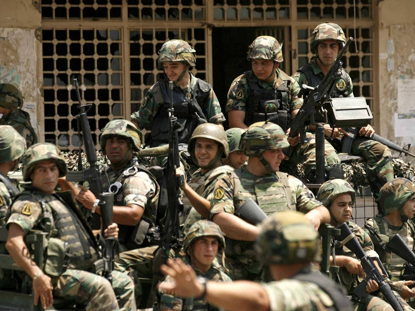 Lebanese army commandos sit on the back of a truck in the Abra district of the southern city of Sidon