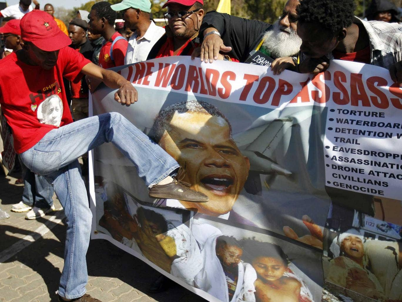 South African protesters campaigning against President Barack Obama's three-nation tour of the continent