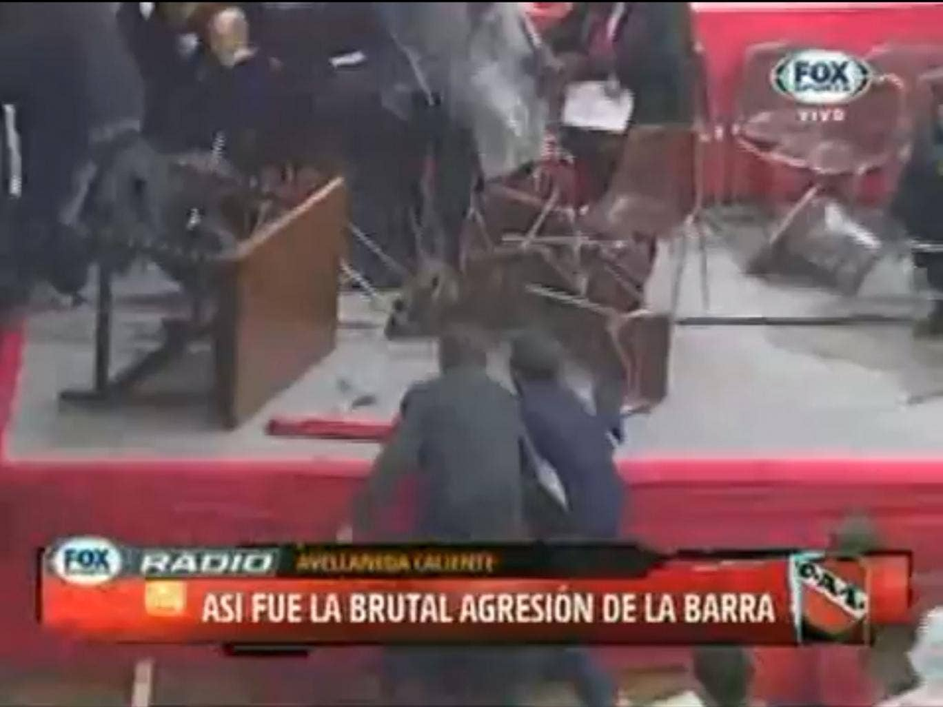 Attack: Supporters bombarded the stage with tables and chairs