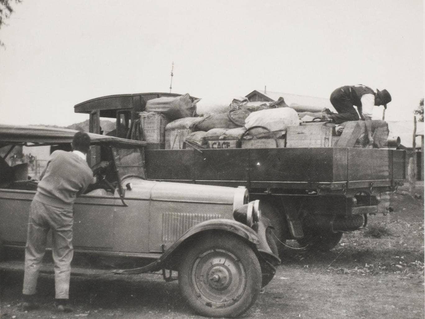 Harold Bell Lasseter, seen right on a truck in Alice Springs in 1930, after finding nuggets 'as big as plums'