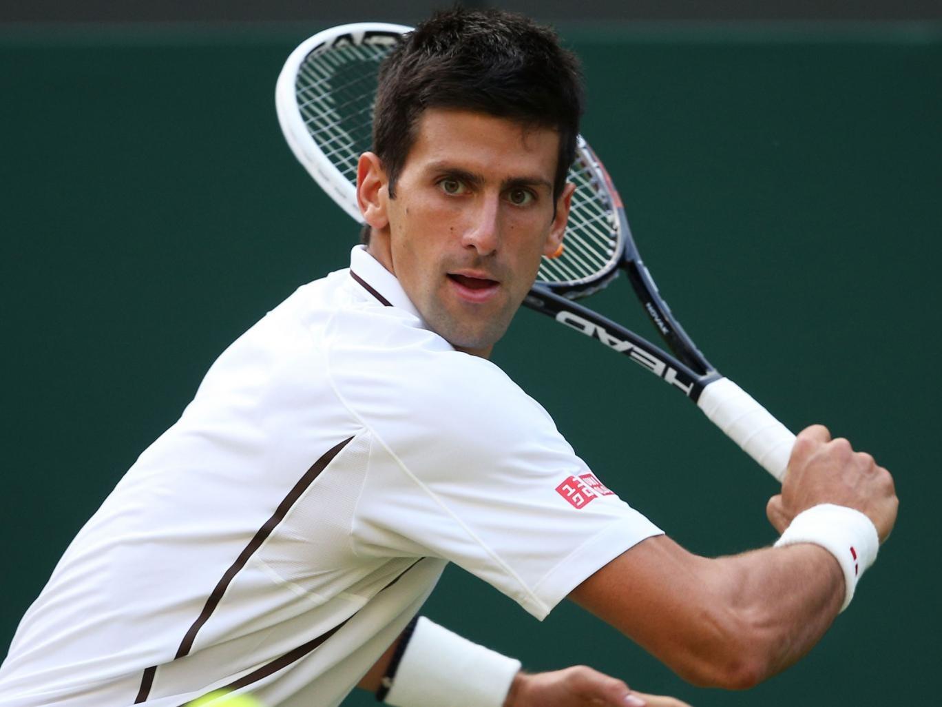 Novak Djokovic plays a backhand against Jeremy Chardy