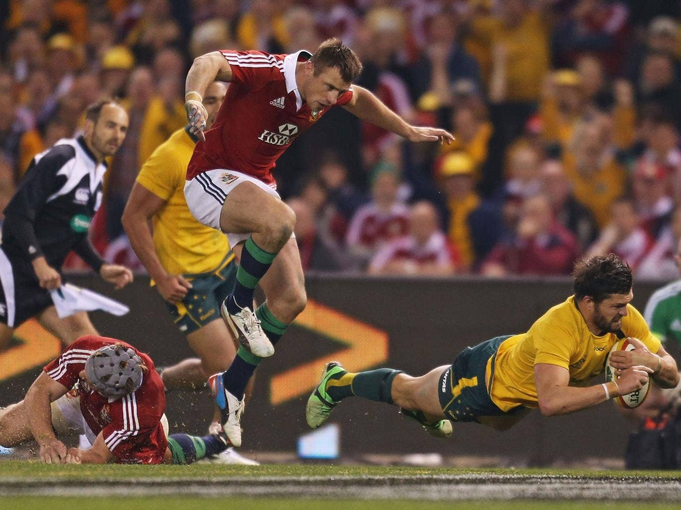 Gold Rush: Australia's Adam Ashley-Cooper dives over for the only try in his side's victory against the Lions in Melbourne