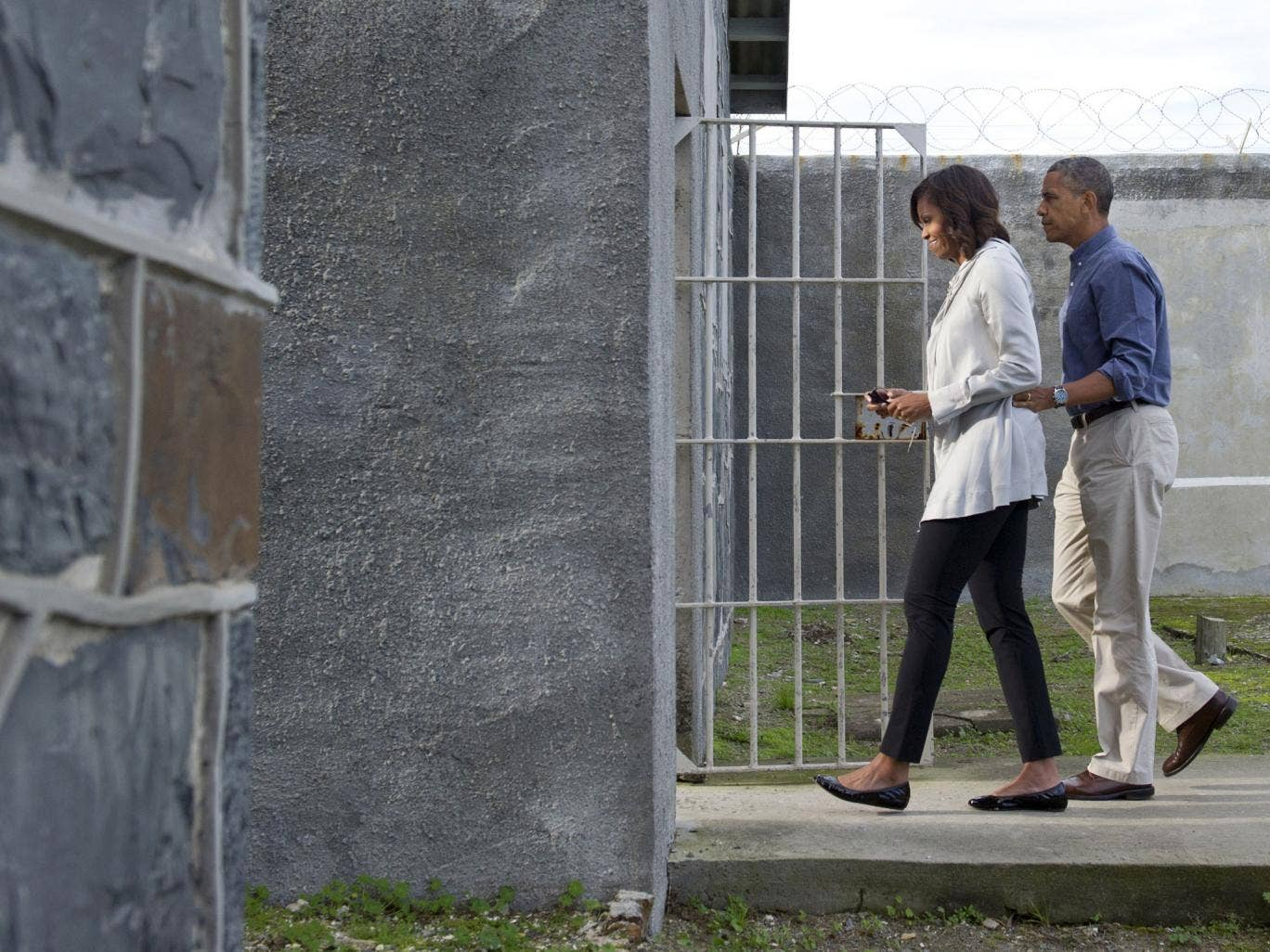 US President Barack Obama, right, and First Lady Michelle Obama, left, tour Robben Island