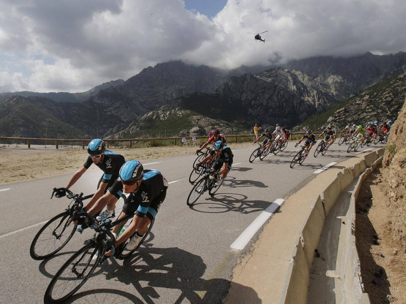 Team Sky's Vasili Kiryienka, right, and Chris Froome, left, lead during stage two yesterday