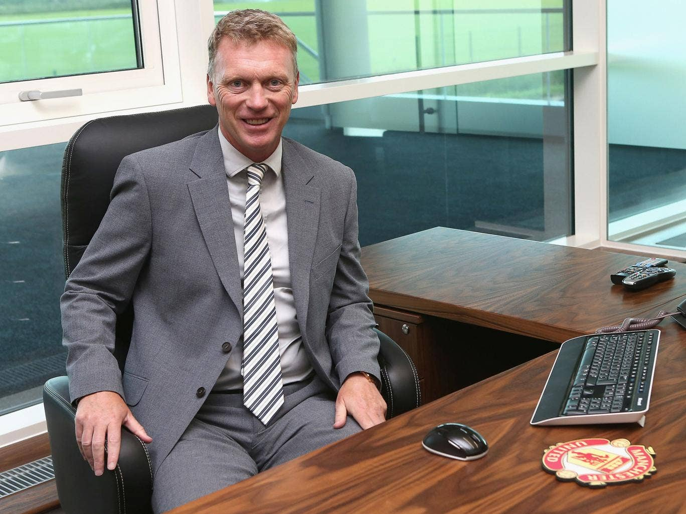 David Moyes gets to grips with his new office on his first day as Manchester United manager