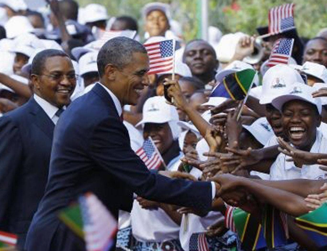 Barack Obama and Tanzania's President Jakaya Kikwete, left, at a welcoming ceremony in Dar Es Salaam