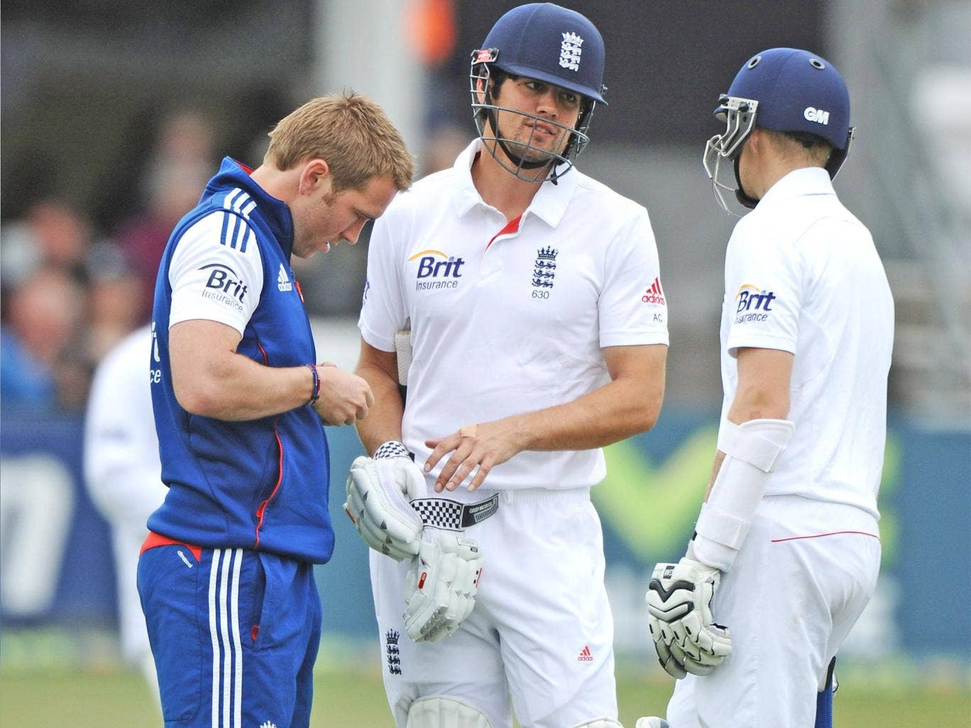 Alastair Cook is given treatment to a hand against Essex