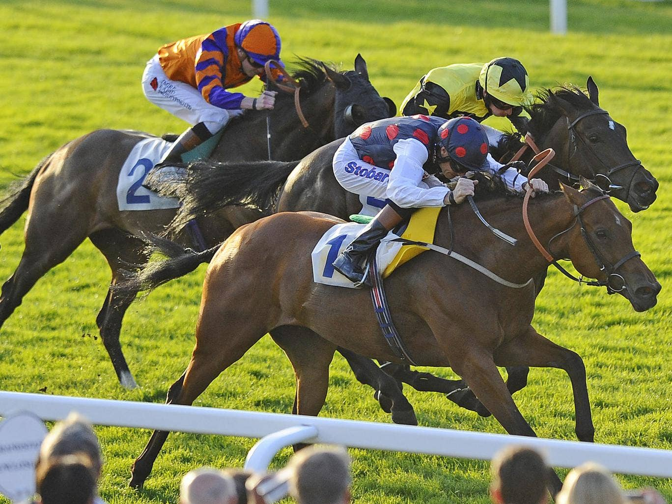 Choral Festival wins the fillies' handicap at Windsor on Monday night, the final leg of a treble for her jockey, Richard Hughes, who reached his century for the season