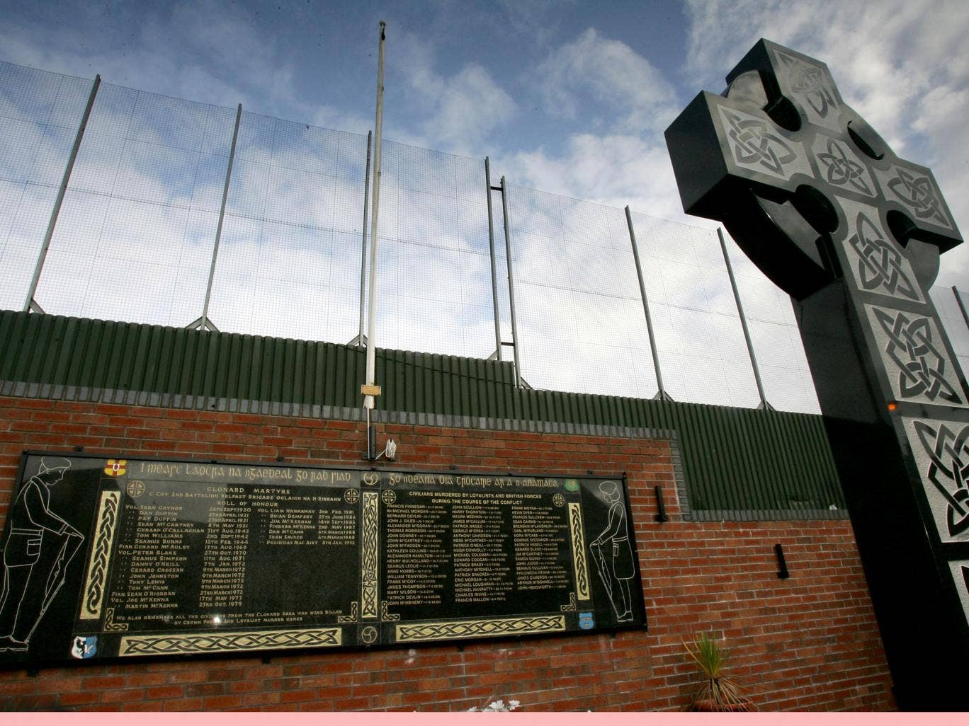 A memorial for IRA volunteers killed in 'the troubles' next to the Peace Line fence in Clonard republican area of West Belfast