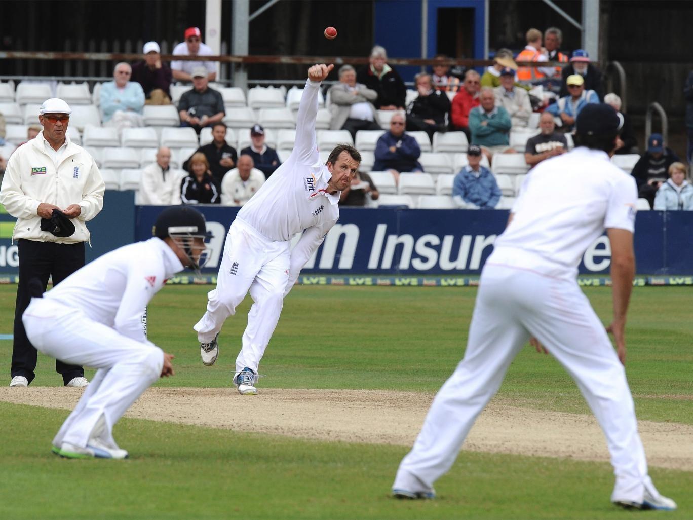 Graeme Swann bowls during England's match against Essex in Chelmsford