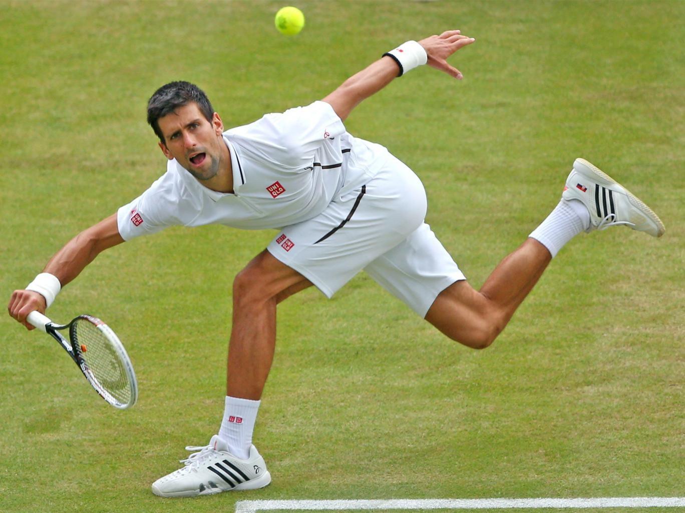 Novak Djokovic plays an awkward shot during his quarter-final victory over Tomas Berdych