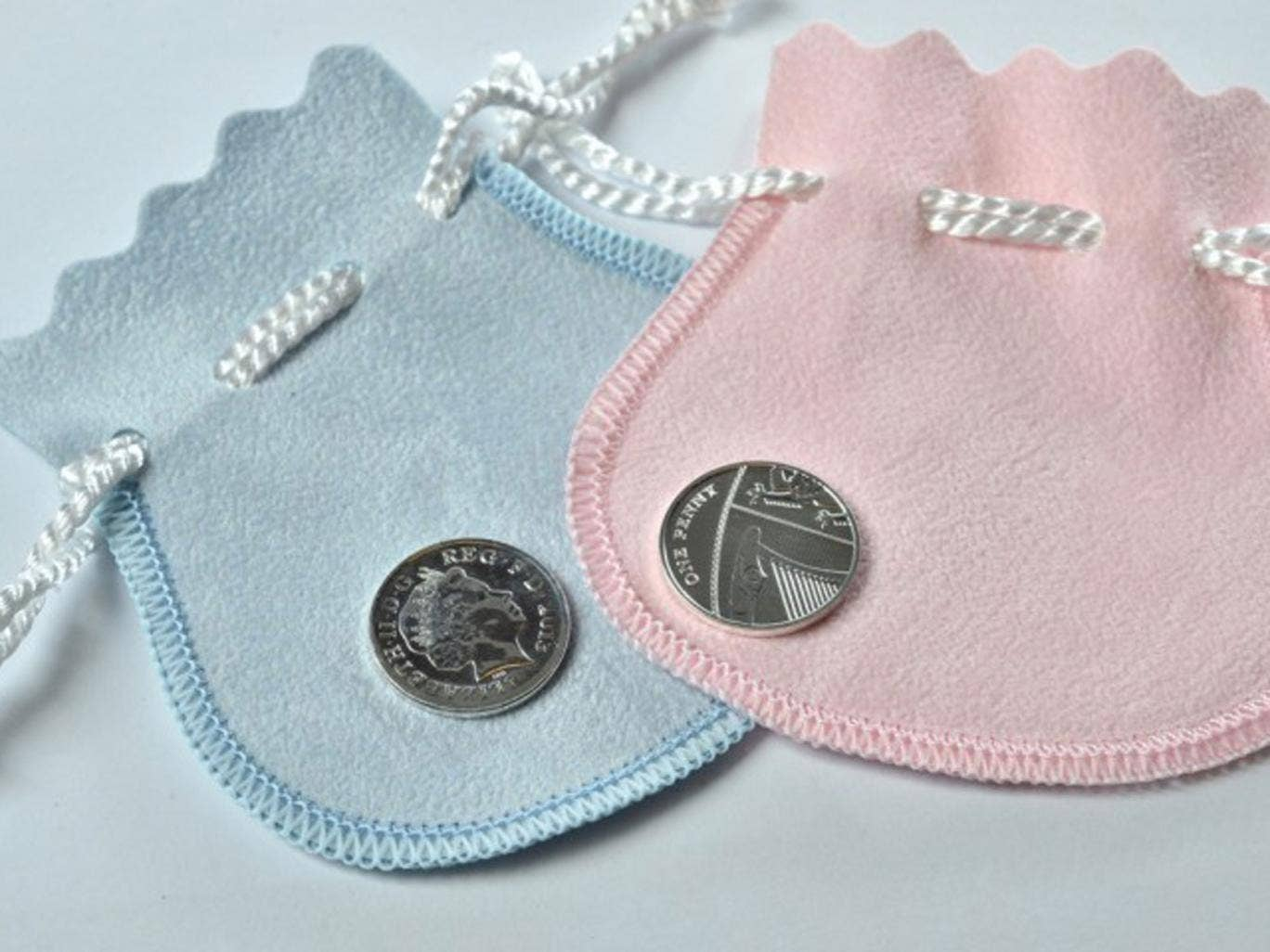 The Royal Mint of a new silver penny coin to commemorate the birth of the Duke and Duchess of Cambridge's baby which will be gifted to babies born on the same day as the future monarch