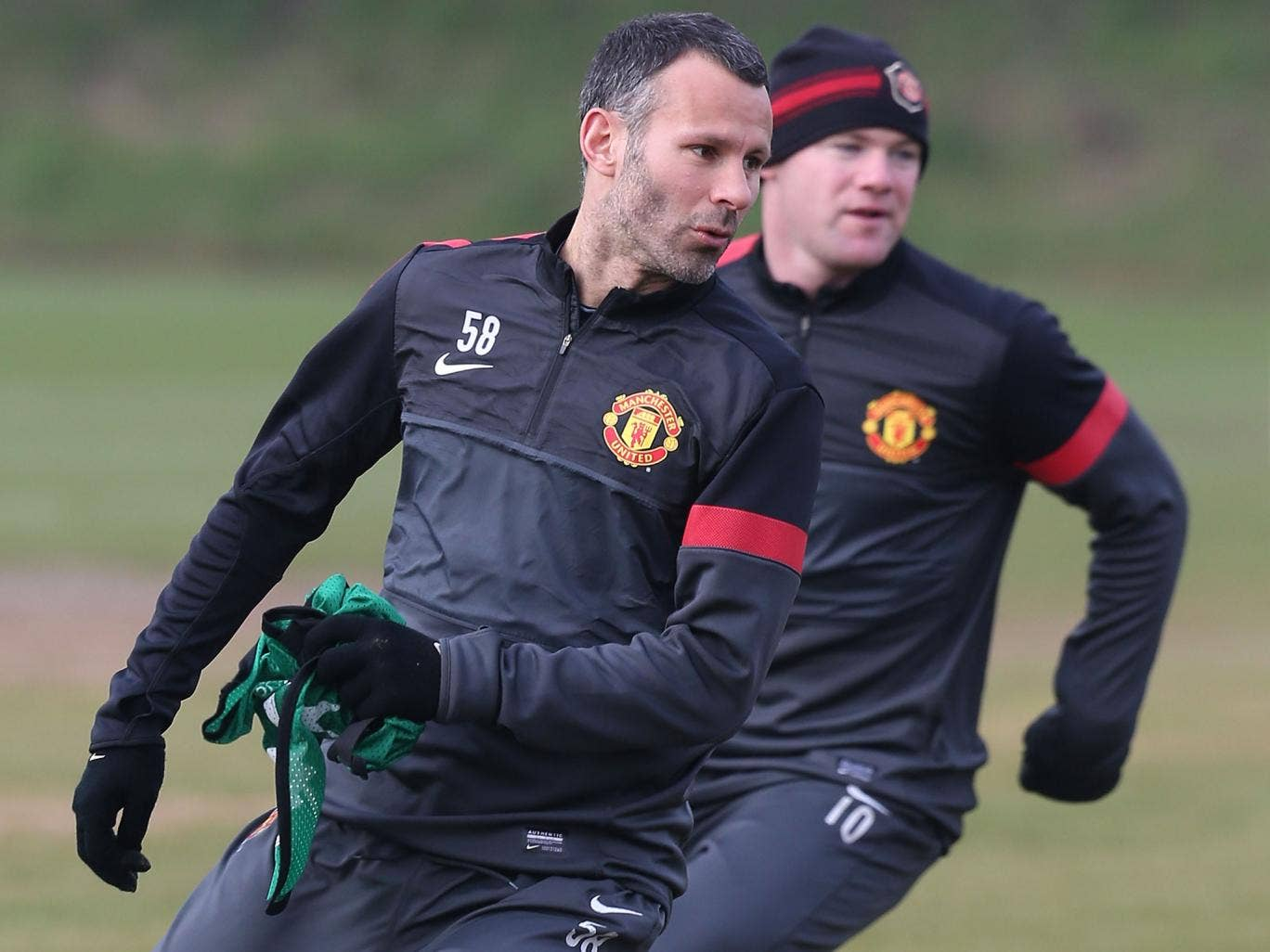 Manchester United hope Ryan Giggs' appointment as player-coach will persuade Wayne Rooney to stay at club