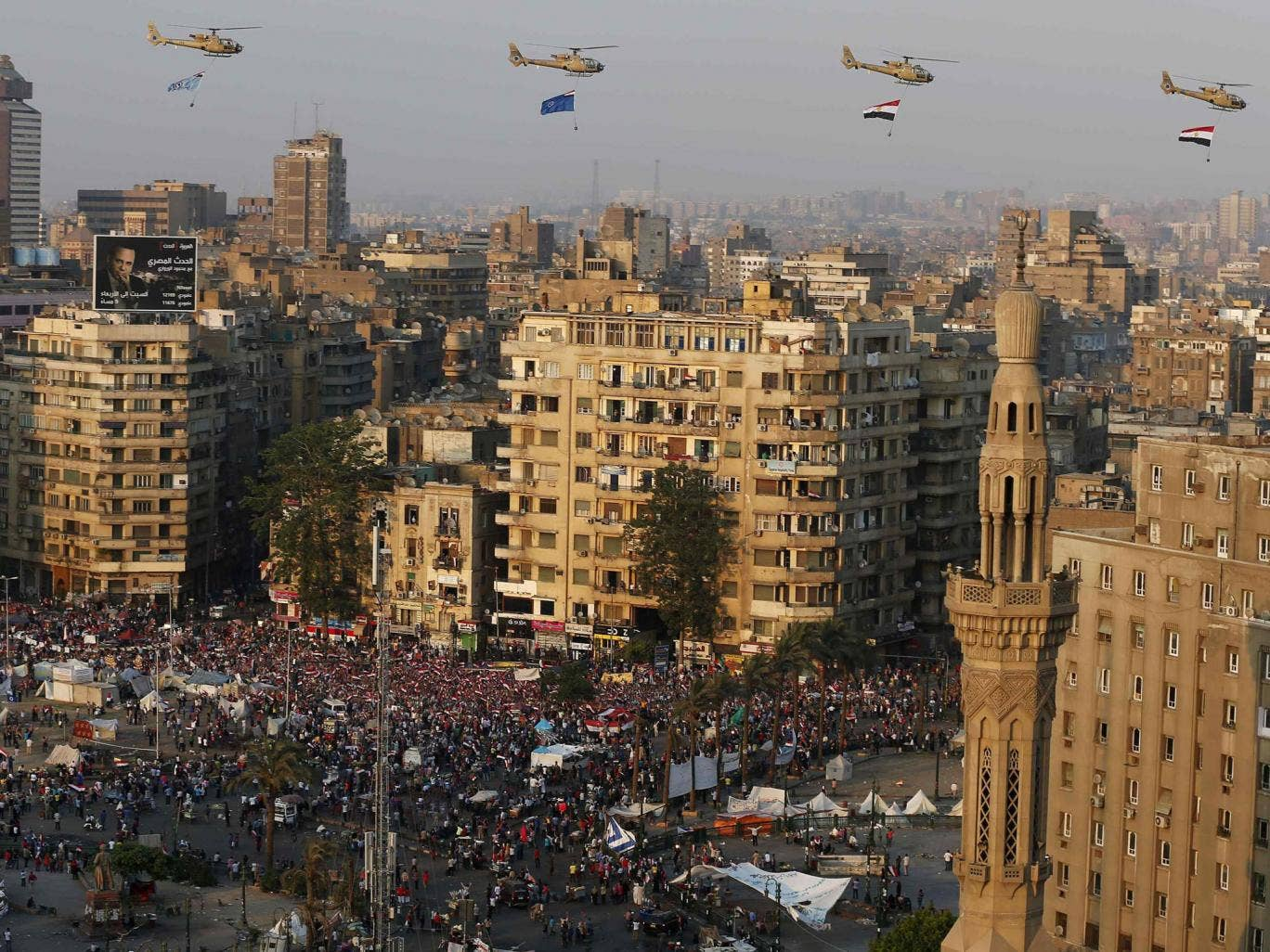 A view shows a fly-past over protesters against ousted Egyptian President Mohamed Morsi, in Tahrir Square