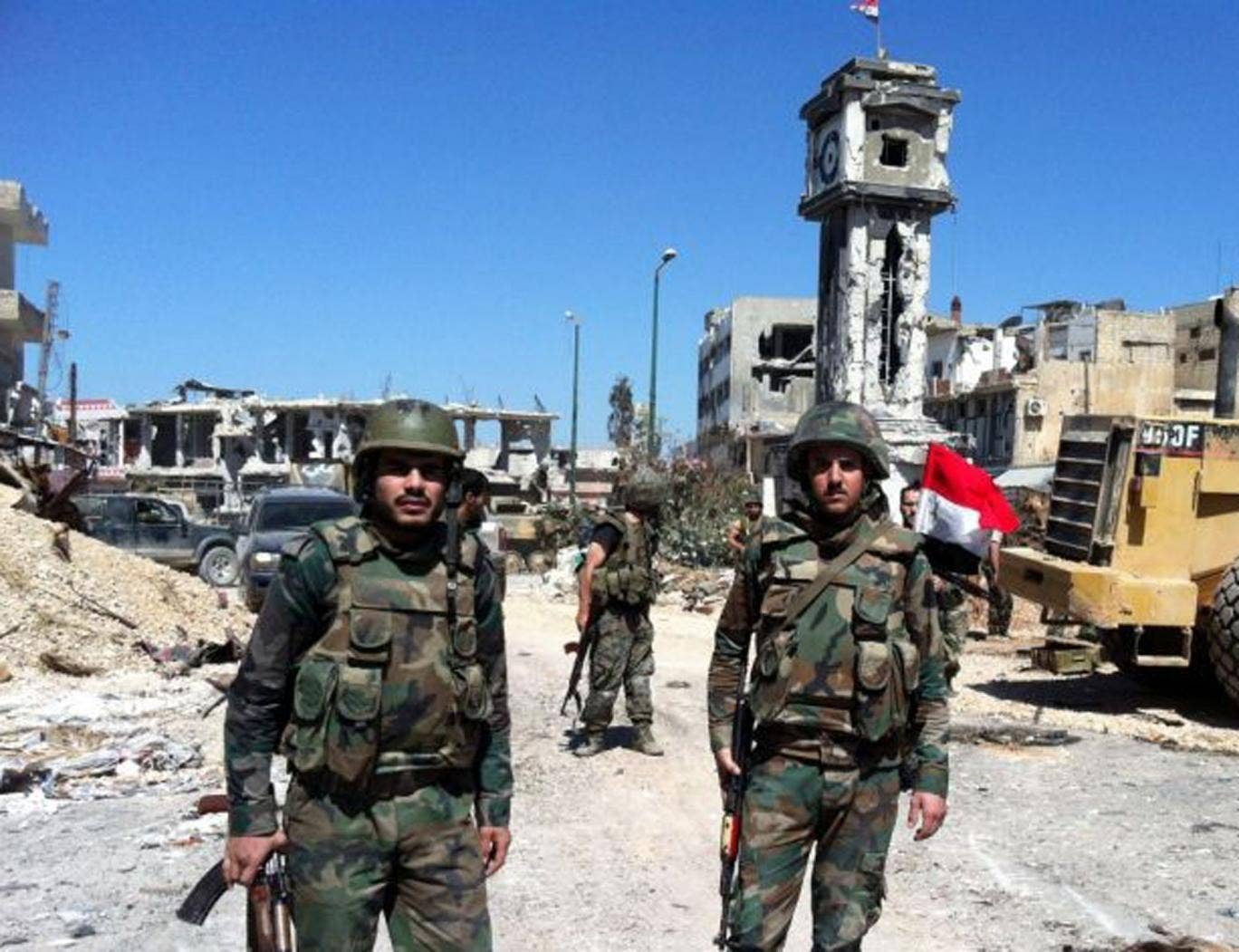Syrian government soldiers in the main square of the city of Qusayr, near the Lebanese border