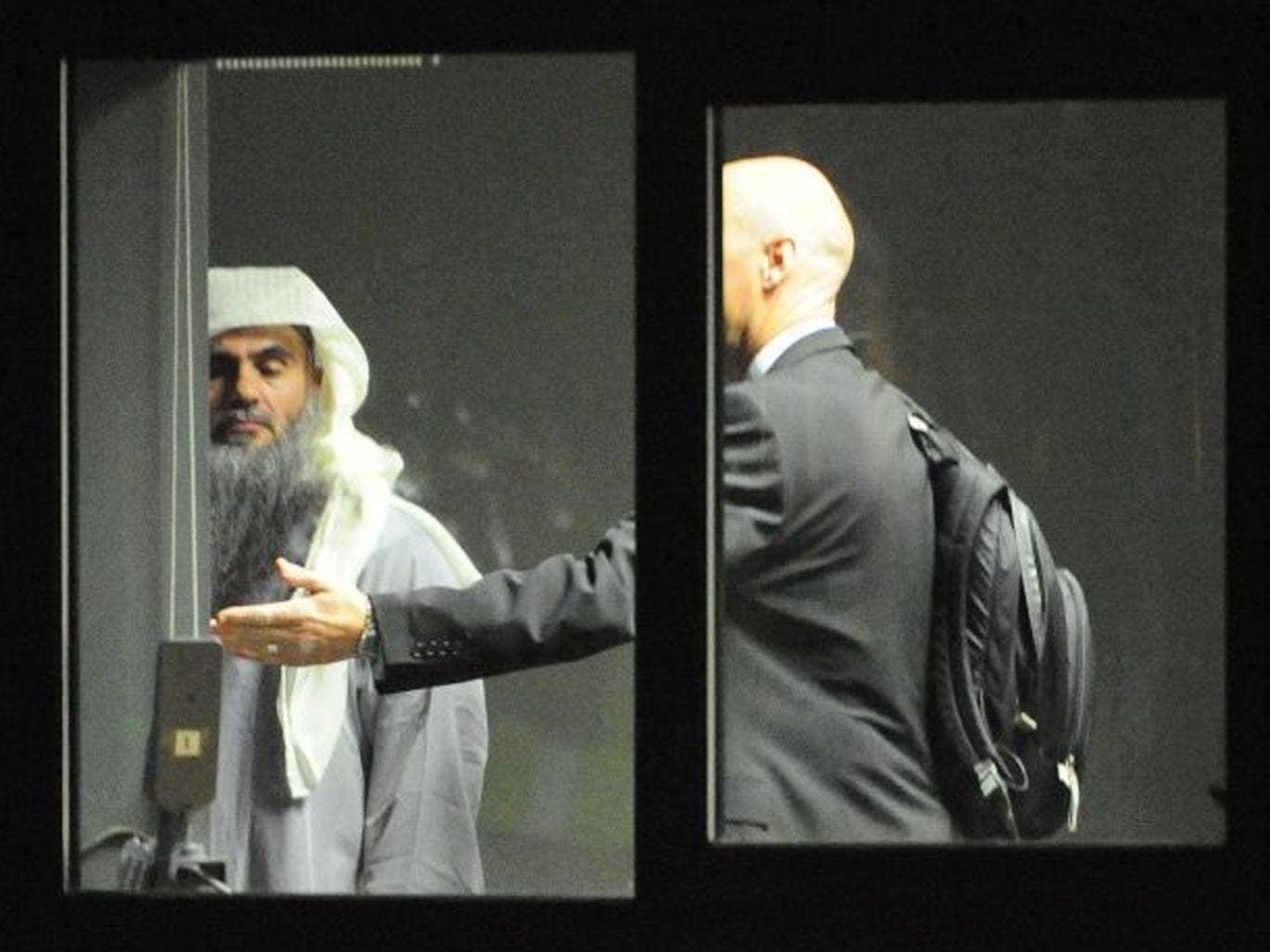 A photograph issued by the Ministry of Defence of Abu Qatada (left) at RAF Northolt in West London where he boarded a private flight bound for Jordan