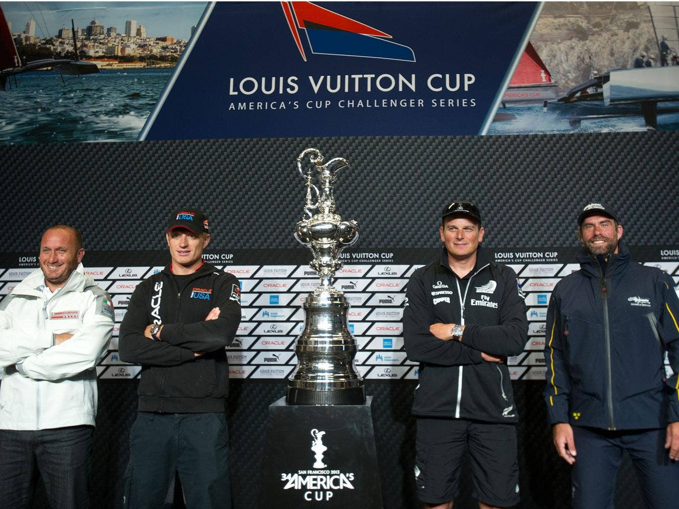 Skippers pose with the America's Cup trophy. From left to right are Luna Rossa Challenge's Max Sirena, Team Oracle USA's Jimmy Spithill, Emirates Team New Zealand's Dean Barker and Artemis Racing's Iain Percy.