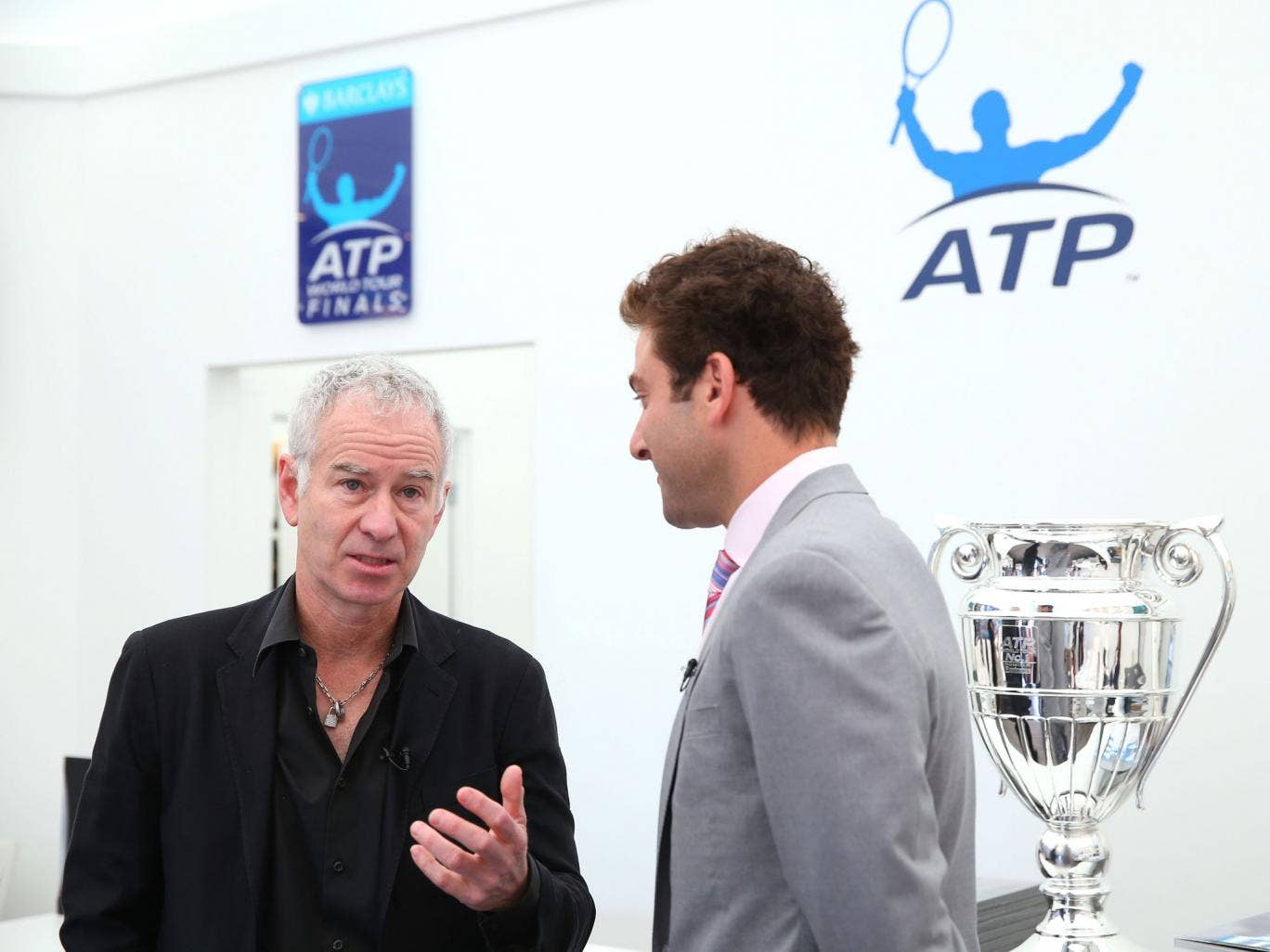Perhaps John McEnroe, left, was indulging Court One with some more knockabout veteran doubles
