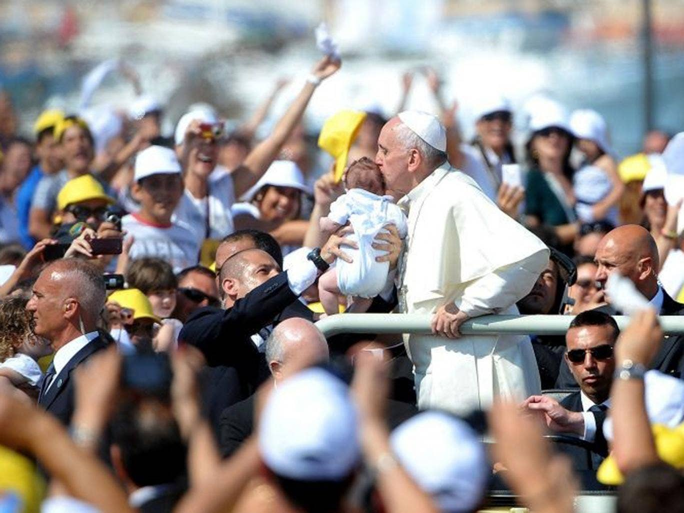 Pope Francis kisses a child as he arrives in the island of Lampedusa