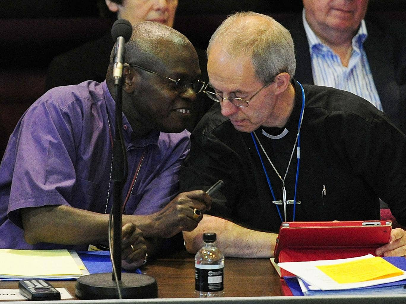 The Archbishop of York Dr John Sentamu and the Archbishop of Canterbury the Most Rev Justin Welby, talk to each other during discussions over women in the Episcopate at the General Synod