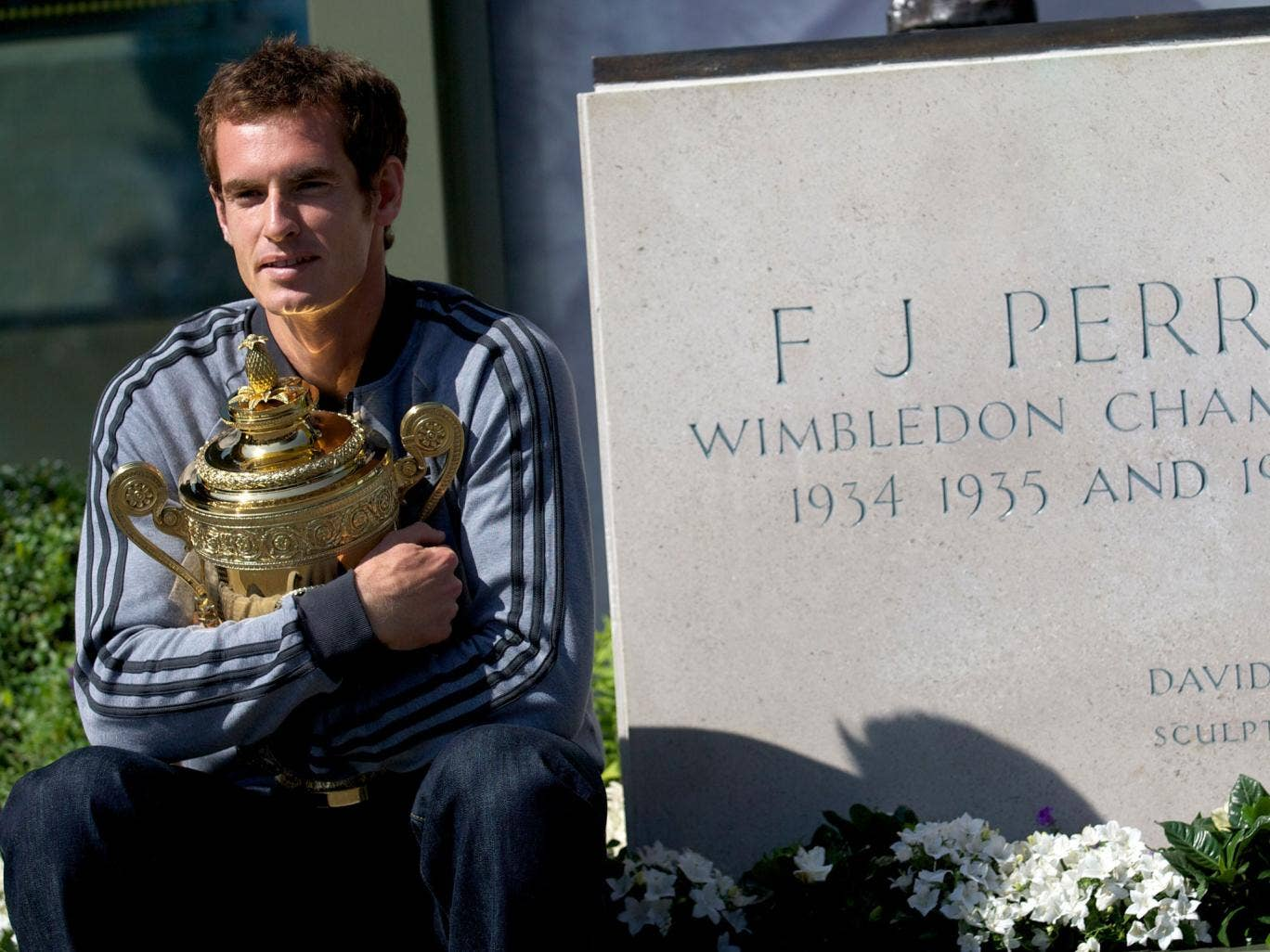 Andy Murray sits beside Fred Perry's SW19 statue