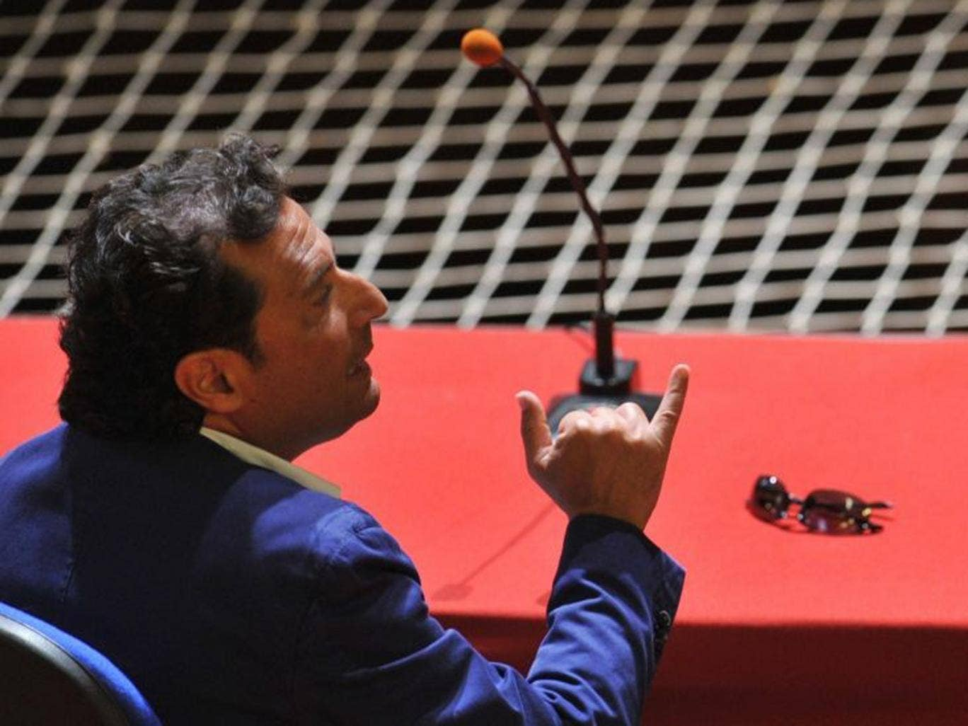The captain of the ill-fated Costa Concordia cruise ship, Francesco Schettino seated for his trial in Grosseto, Tuscany. He is charged with multiple manslaughter over the 32 people who lost their lives and is accused of abandoning the ship while terrified