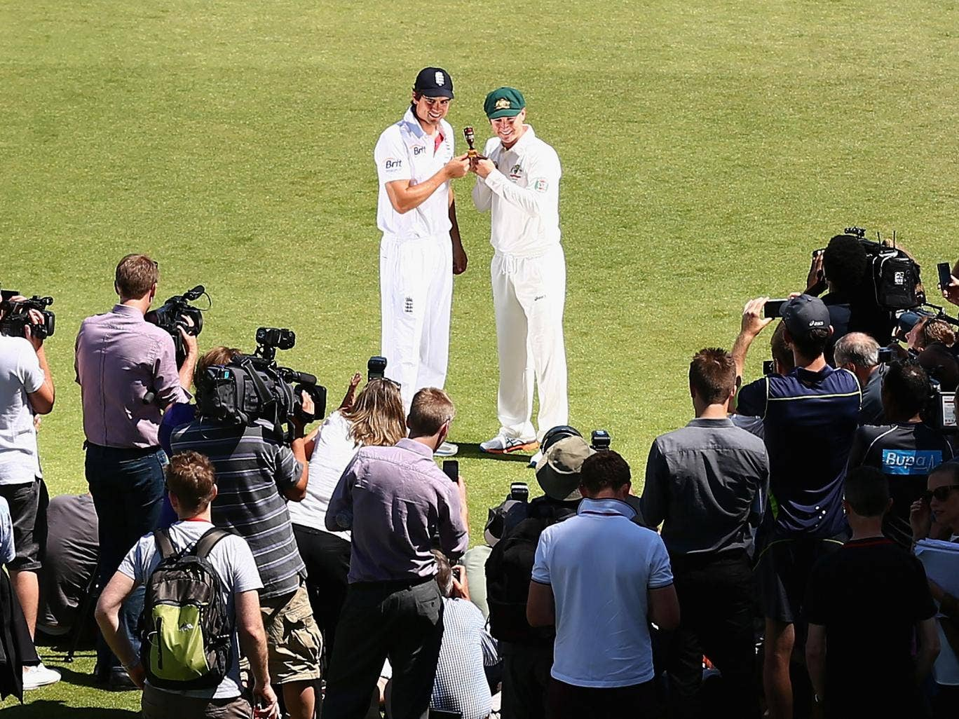 England captain Alastair Cook and Australia captain Michael Clarke pose with the Ashes urn