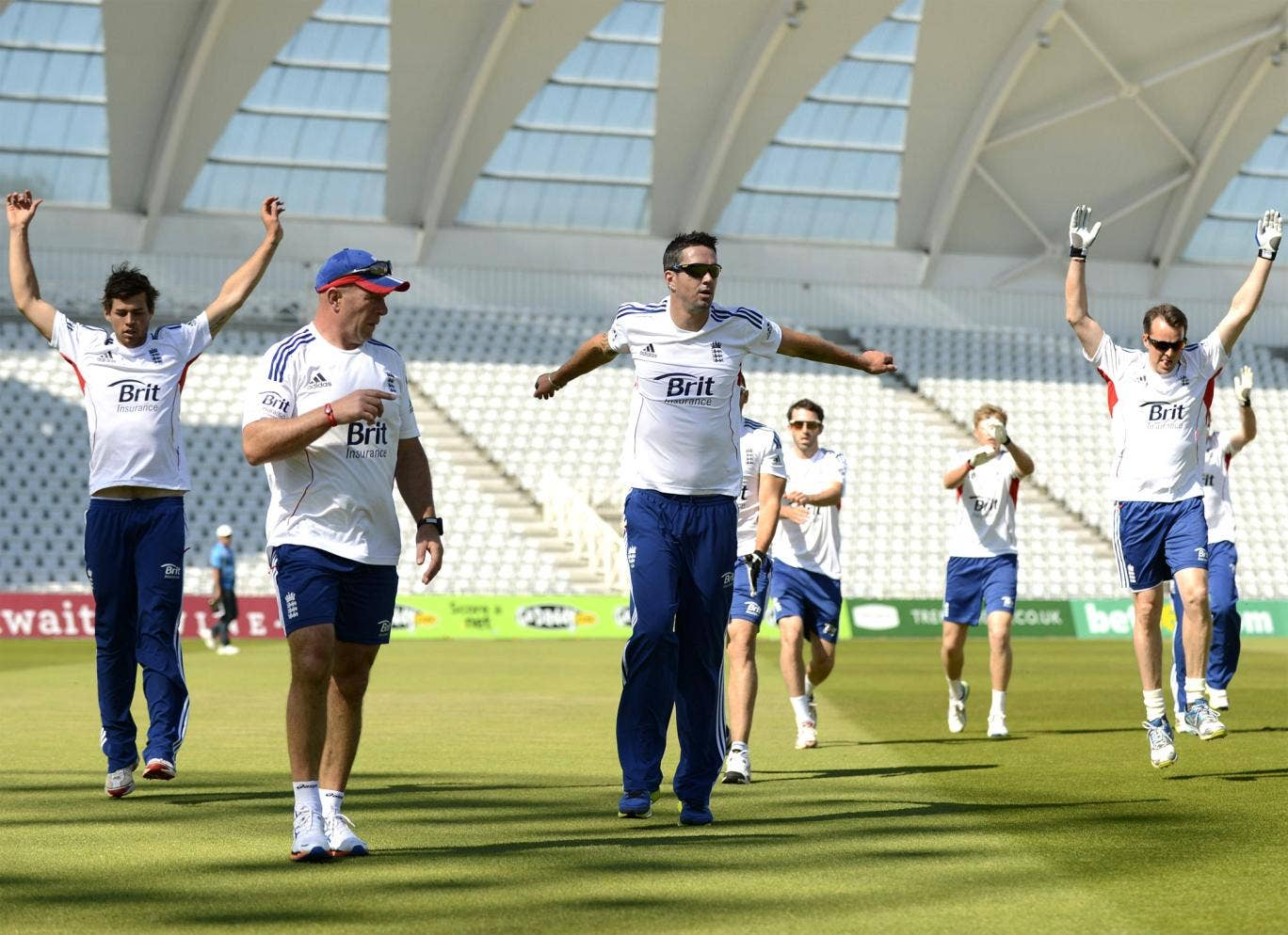 Kevin Pietersen (third left) warms up with his England teammates