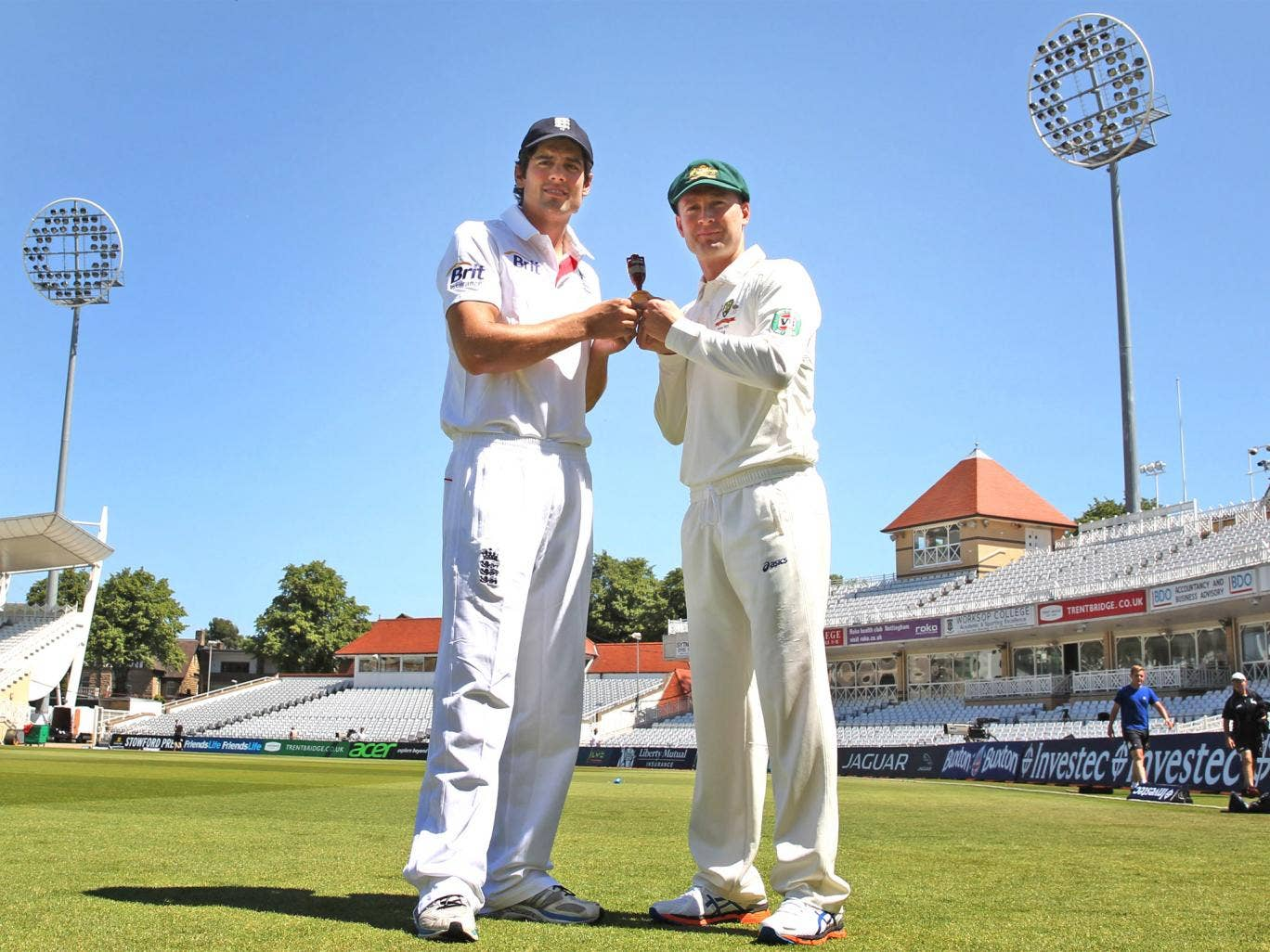 England's Alastair Cook (left) with Australia captain Michael Clarke