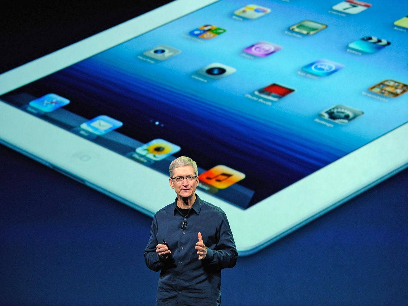 Apple CEO Tim Cook unveiling the fourth generation iPad in 2012