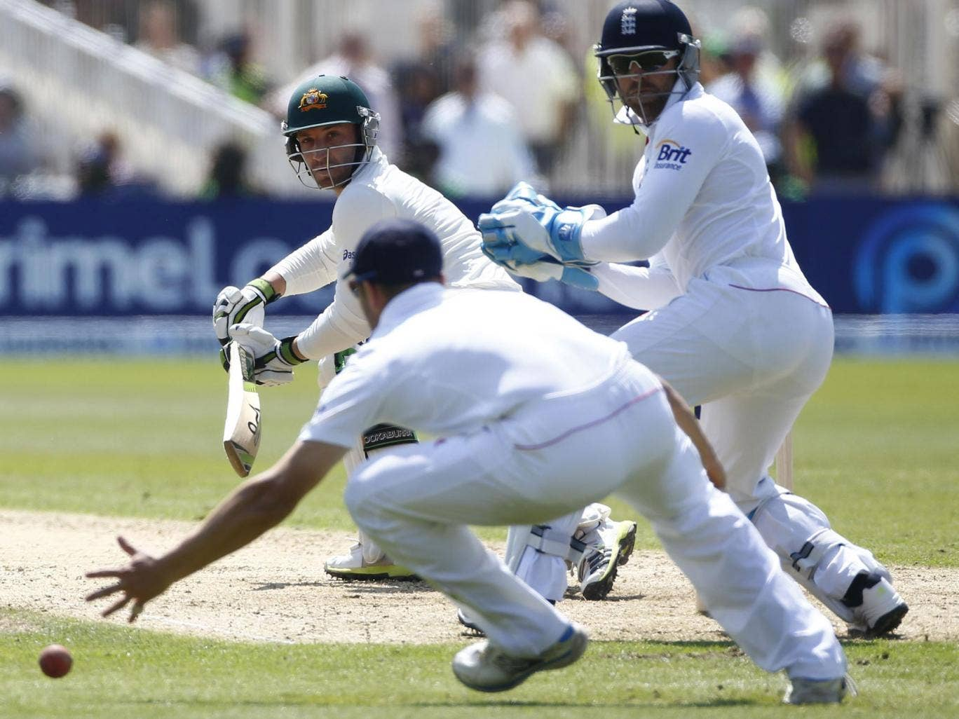 Phil Hughes steers the ball past England's Matt Prior (right)