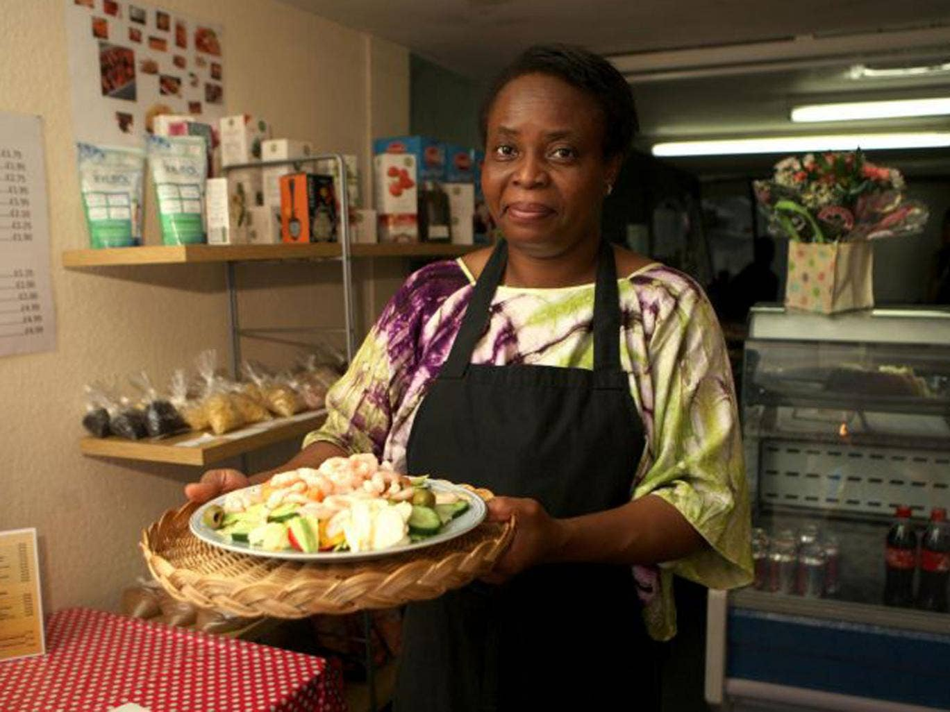 Martha-Renée Kolleh, runs her Yeanon Cafe in the market square in the old West Yorkshire mill town of Ossett