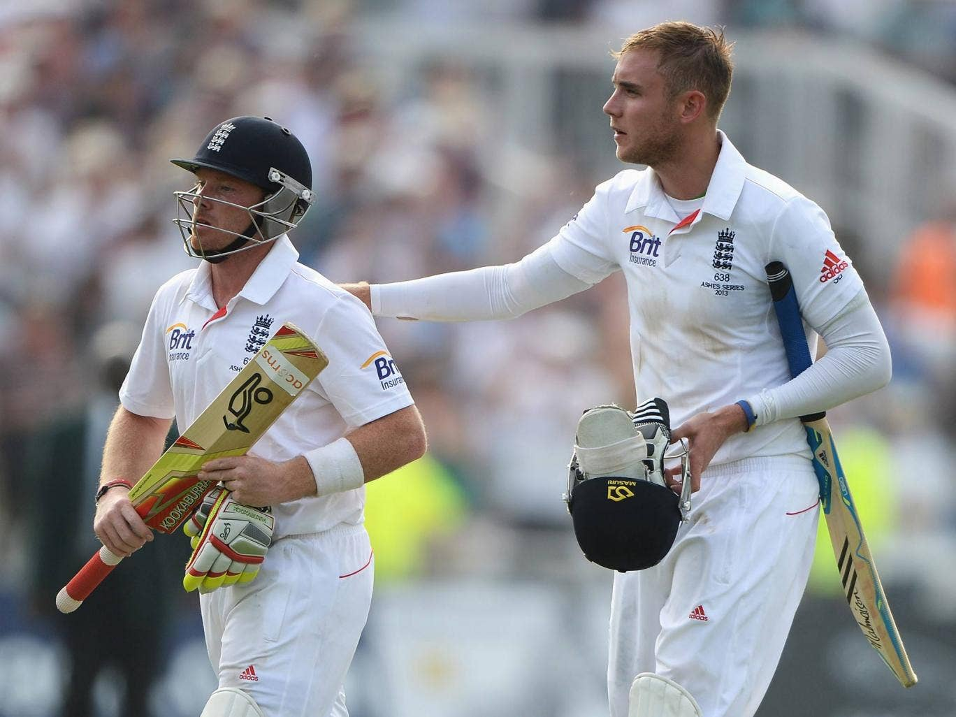 Ian Bell and Stuart Broad leave the field at the end of Day Three