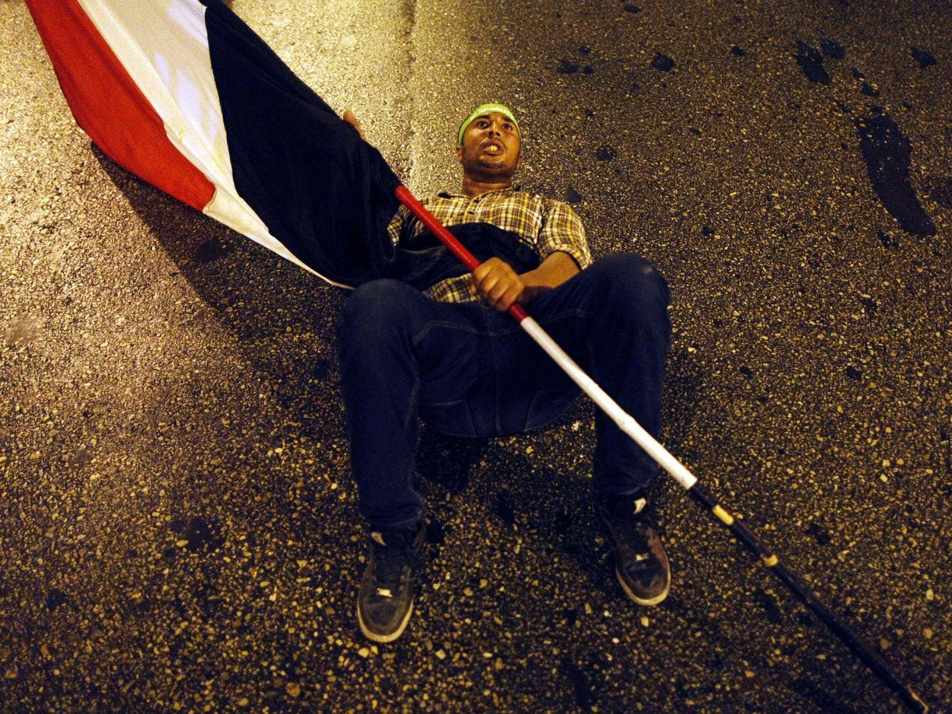Down, not out: A supporter of the ousted Mohamed Morsi in Cairo